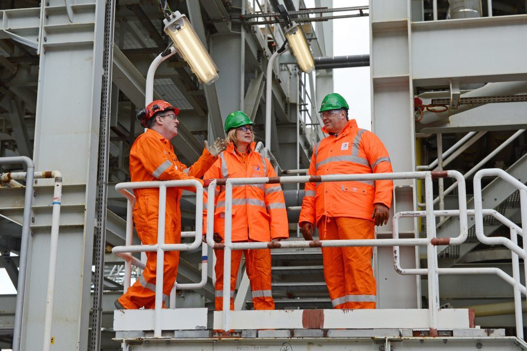 Decc scrapped: Pictured former Secretary of Energy and Climate Change Amber Rudd (centre)