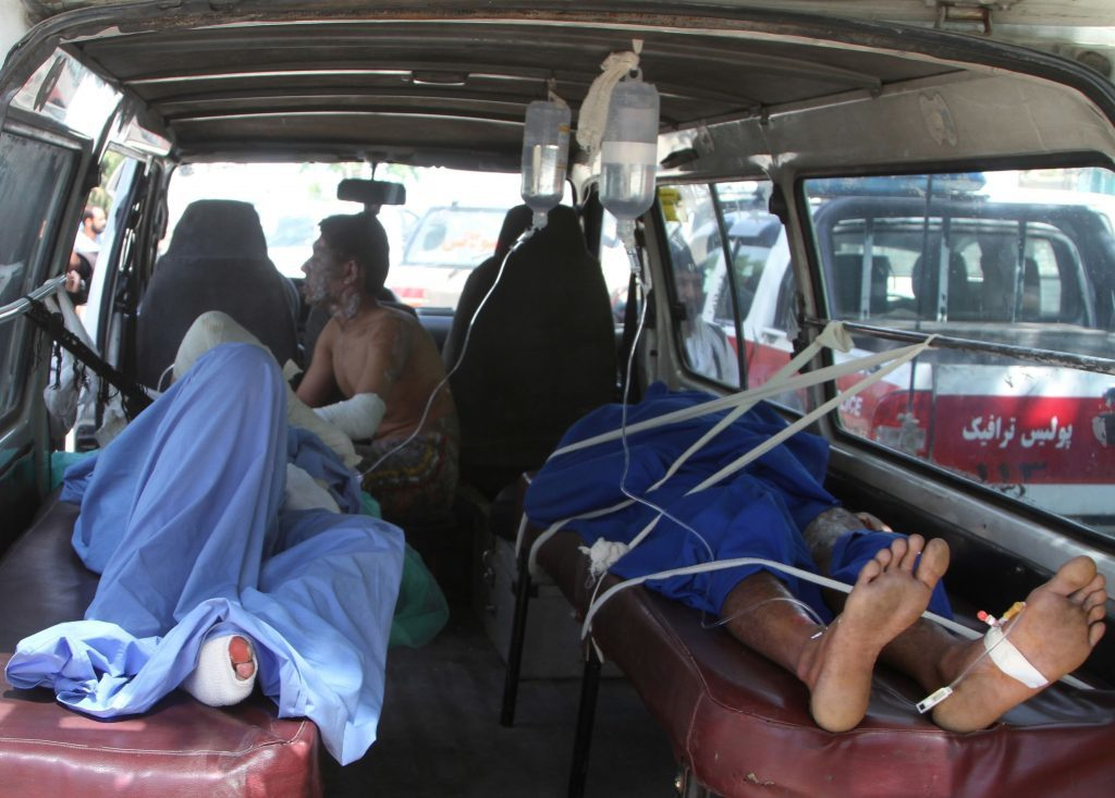 Injured Afghan men lie in an ambulance after an accident on the main highway linking the capital, Kabul, to the southern city of Kandahar, in Ghazni province eastern of Kabul, Afghanistan