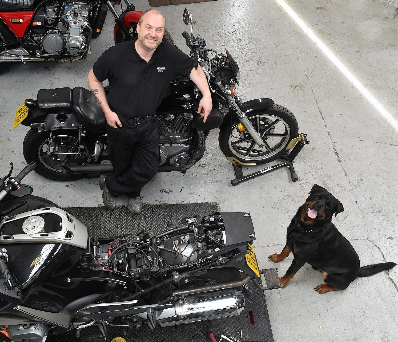 Adam Grozier pictured with his dog, Tig, at Caledonian Customs in Laurencekirk.