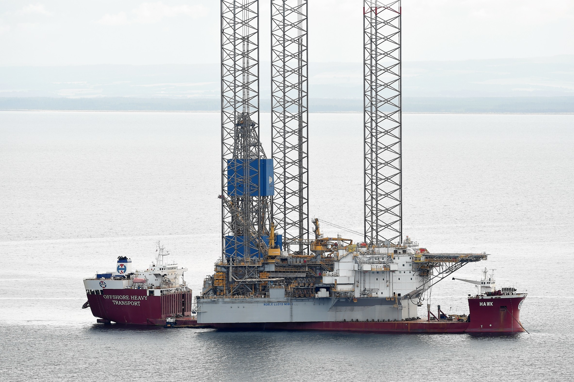The large jack up oil rig 'Noble Lord Noble' sits on the deck of the Norwegian heavy lift ship 'Hawk' in the Moray Firth before entering the Cromarty Firth yesterday (Fri).