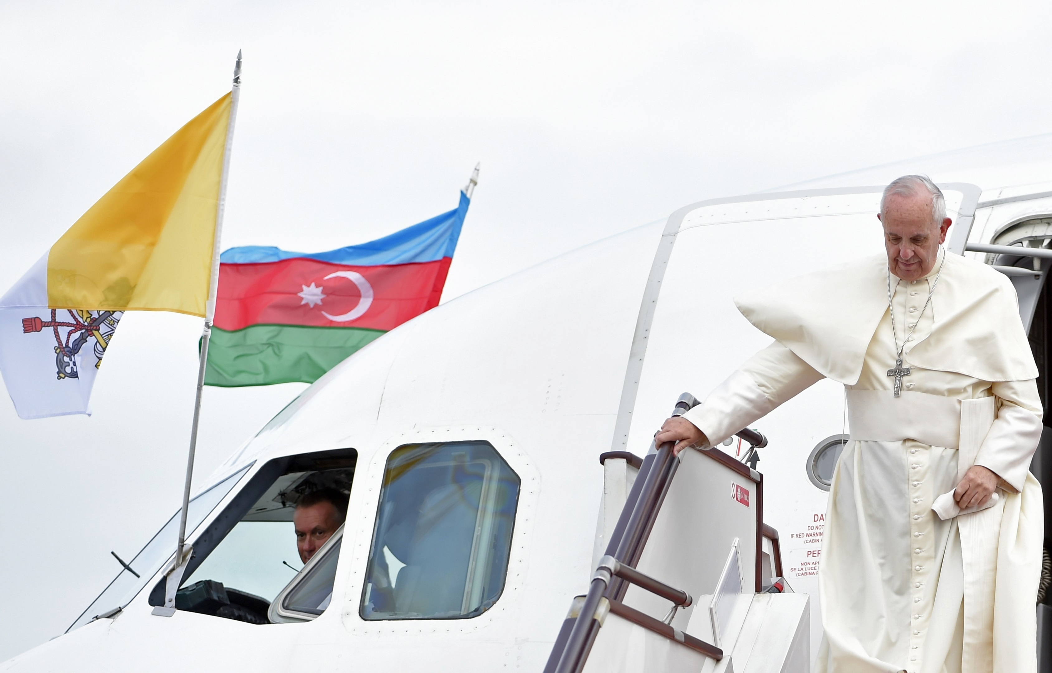 Pope Francis disembarks from a plane that brought him to Azerbaijan's capital Baku, Sunday, Oct. 2, 2016.