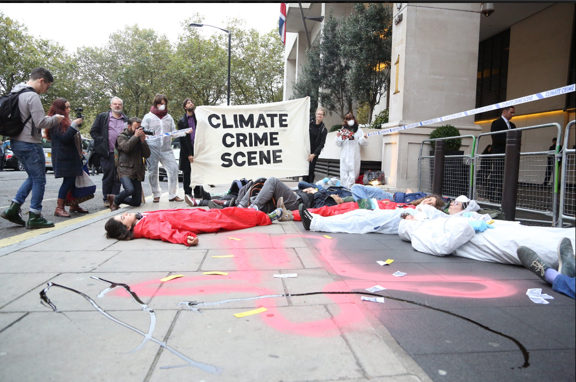 Protesters have created a crime scene outside an oil conference
