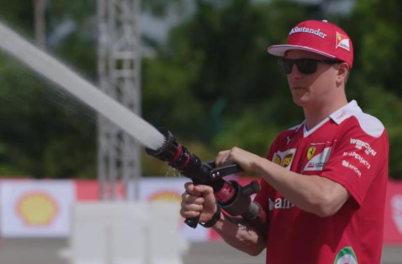 Kimi Raikkonen using a fire hose