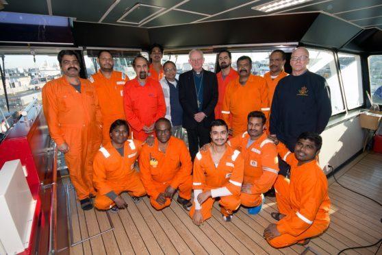 Bishop Hugh Gilbert with the stranded crew of Malaviya Seven