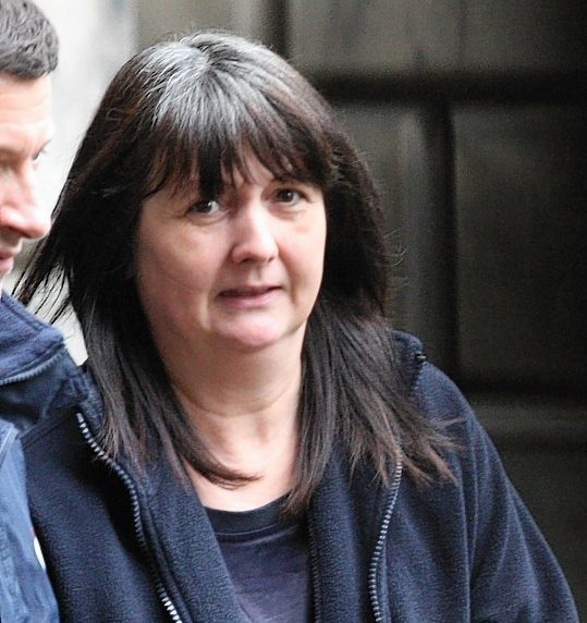 Jacqueline McPhie being taken from Edinburgh High Court yesterday . Photo by Lesley Donald.