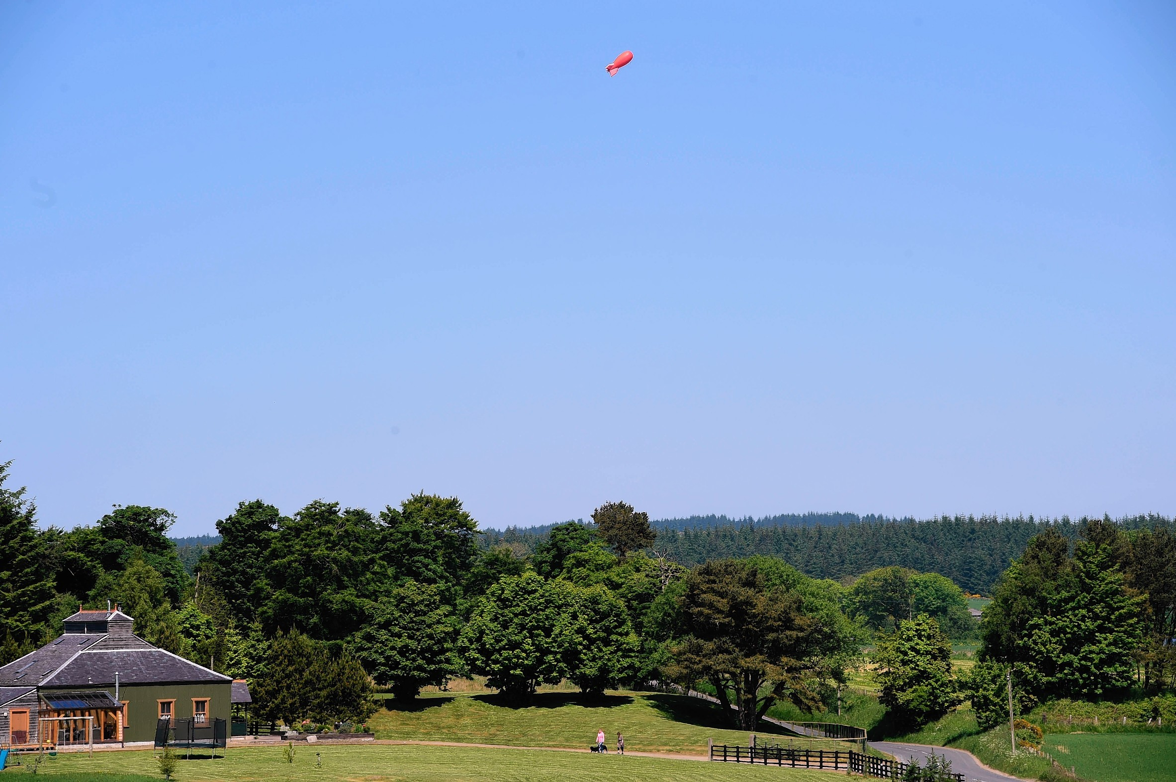 The blimp hired by Cornhill residents demonstrate the height the proposed wind turbine would reach. (Ross/Brown)