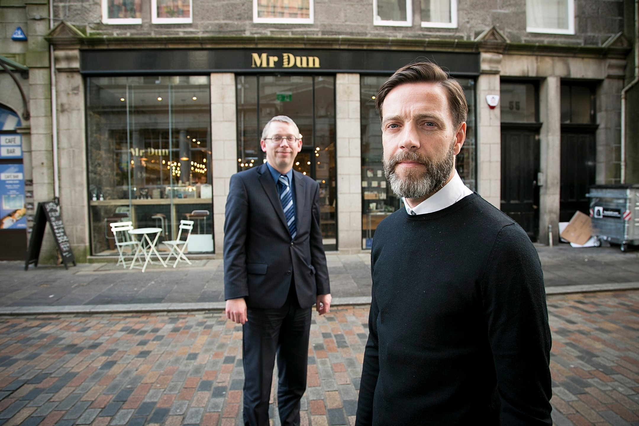 Owner, Dean Walker, in foreground and Douglas Henderson, regional manager at Bank of Scotland in background
