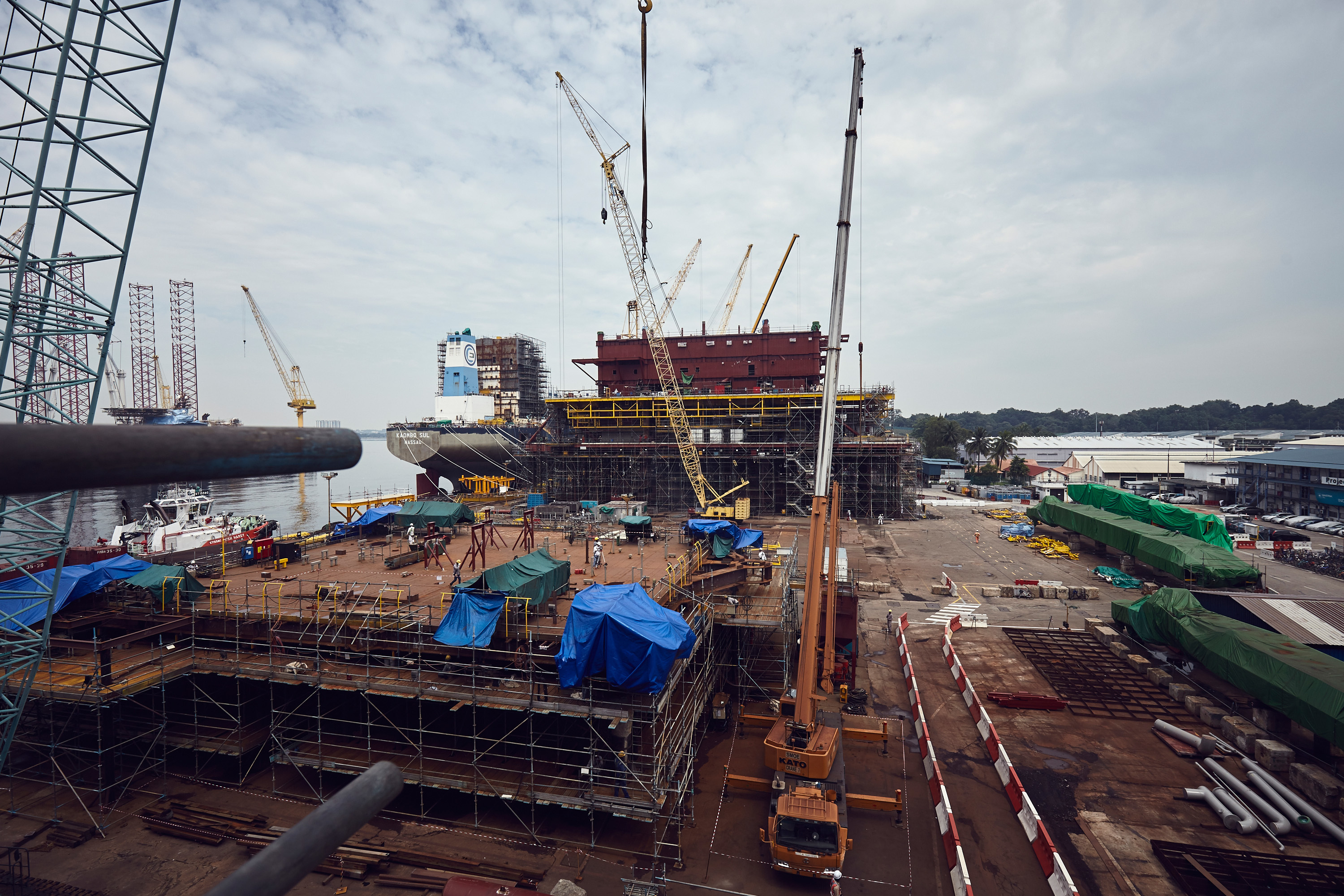 The Culzean utilities and living quarters topside, behind cranes, seen from one of the decks of the central processing facility in a yard in Singapore.