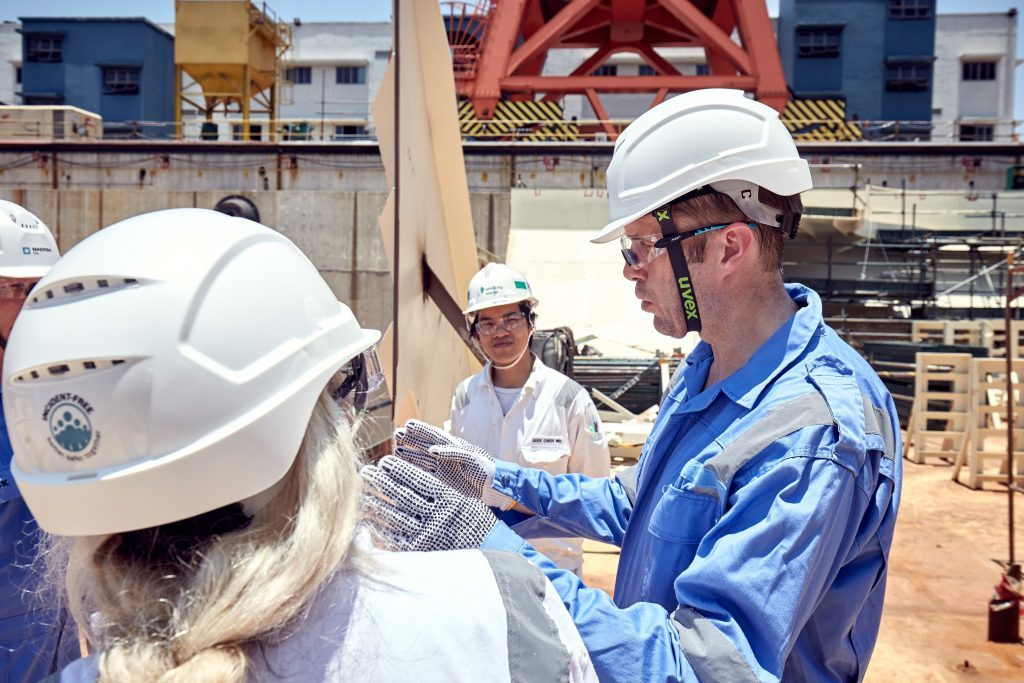 Stuart McAuley, engineering manager for Maersk's Culzean project, right, speaking to visitors to Sembcorp Marine's Tuas yard, where the Culzean floating storage and offloading (FSO) unit is being built. All photographs courtesy of Alfred NG Photography and Maersk Oil.