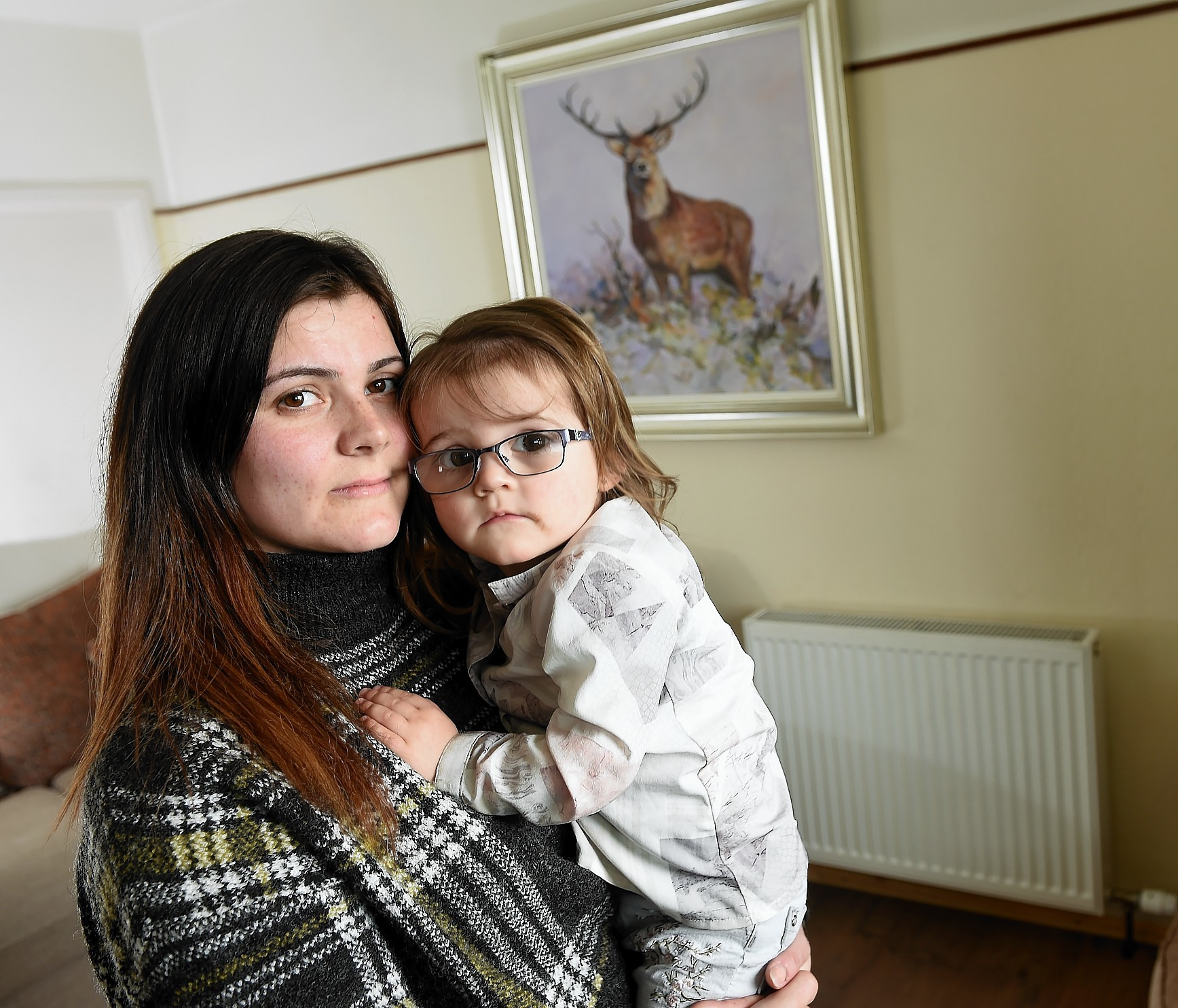 Lisa Ross of Kessock Road, Inverness with her daughter Layla (2), who is having her radiators replaced along with dozens of other residents in South Kessock following the installation of ones of the wrong size.