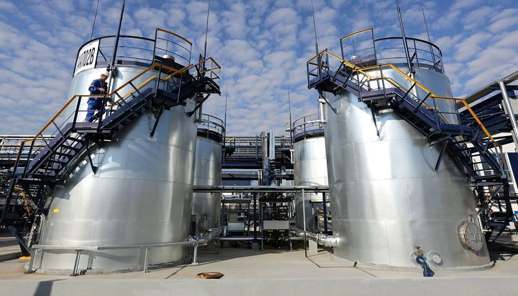 A Gazprom employee climbs the metal ladder alongside tanks at the OAO Gazprom Neft oil refinery in Moscow, Russia, on Thursday, Sept. 20, 2012. Photographer: Andrey Rudakov/Bloomberg