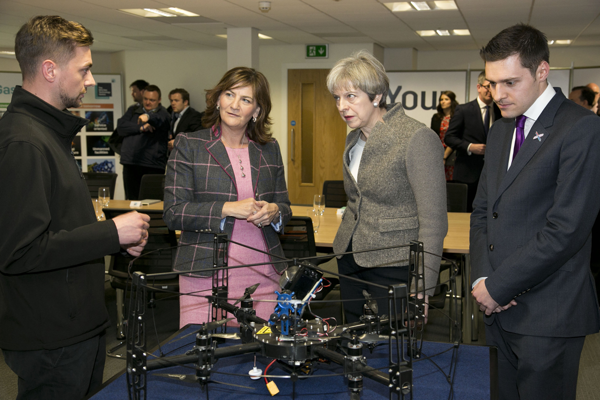 Oil and Gas Technology Centre chief executive Colette Cohen, second left, gives Prime Minister Theresa May and Aberdeen South prospective parliamentary candidate Ross Thomson, right, a tour of the OGTC