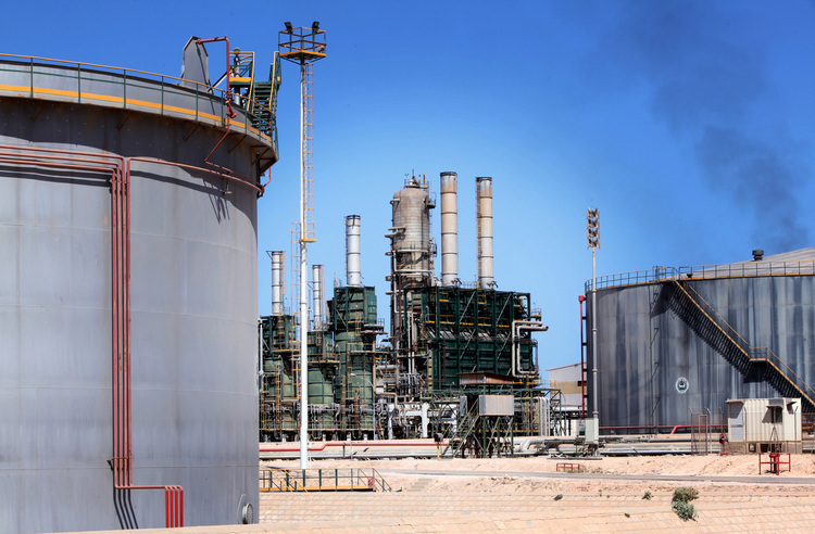 Refining towers and fuel storage tanks are seen at the Zawiya oil refinery near Tripoli, Libya, on Monday, Aug. 29, 2011.  Photographer: Shawn Baldwin/Bloomberg