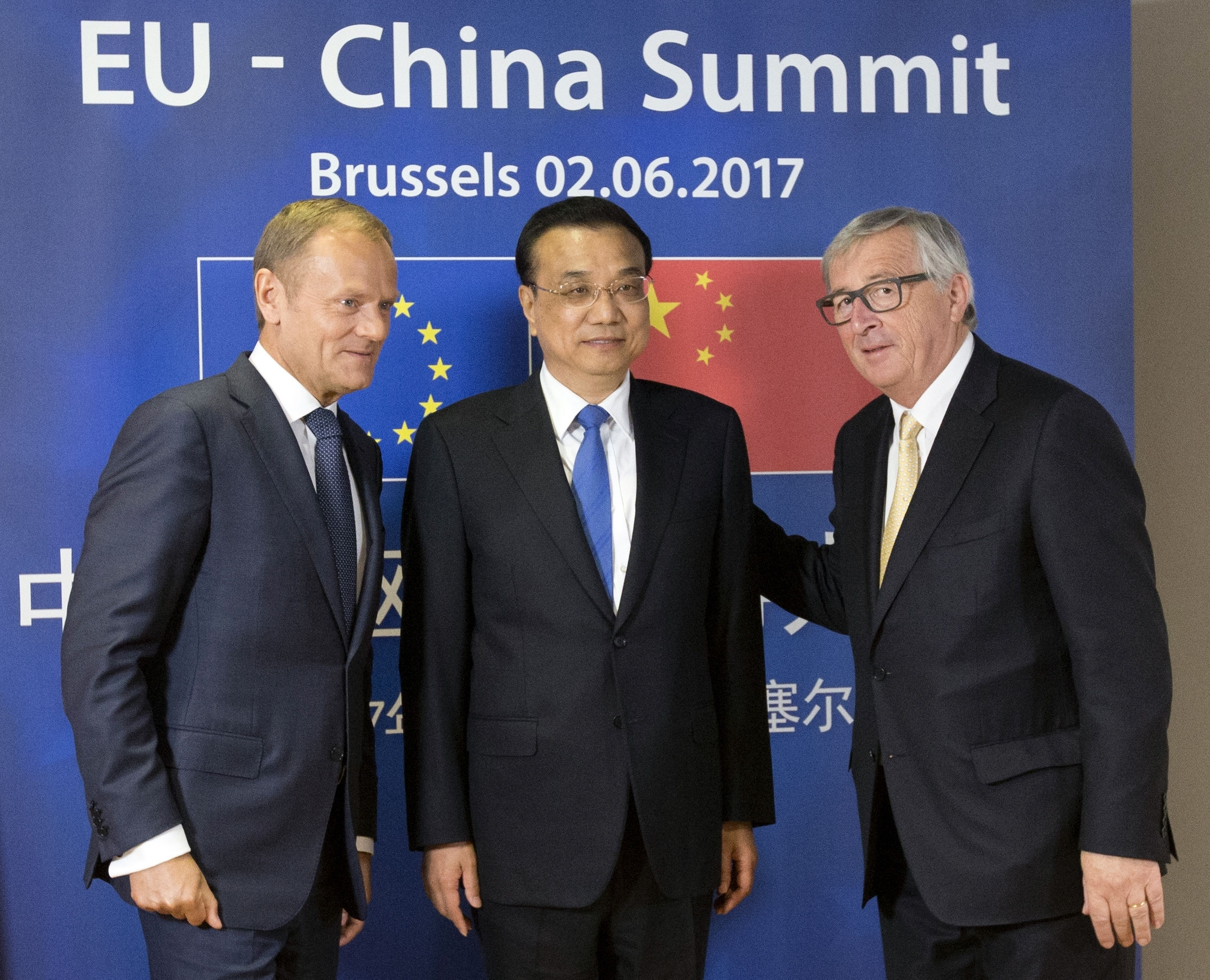 European Commission President Jean-Claude Juncker, right, and European Council President Donald Tusk, left, pose with Chinese Premier Li Keqiang prior to a meeting at the EU-China summit in Brussels, on Friday, June 2, 2017. (Olivier Hoslet, Pool Photo via AP)
