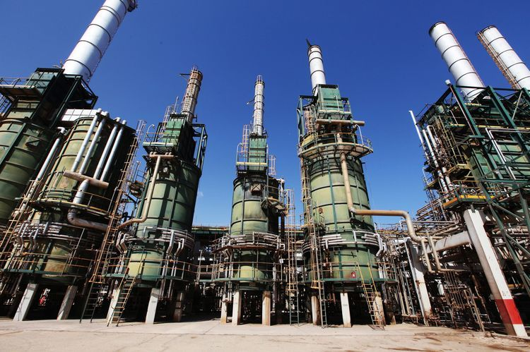 Refining towers are seen at the Zawiya oil refinery near Tripoli, Libya. Photographer: Shawn Baldwin/Bloomberg