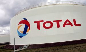 Total holds the dividend, cuts debt