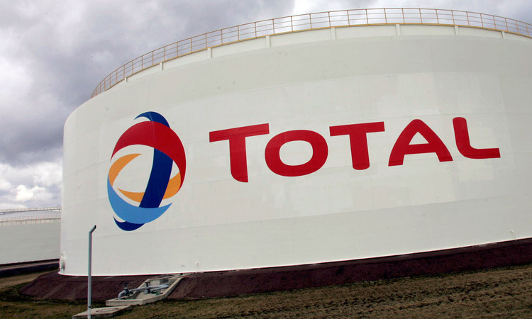Total has maintained its dividend and cut debt amid strong performance from the upstream and marketing, even while refining suffers.