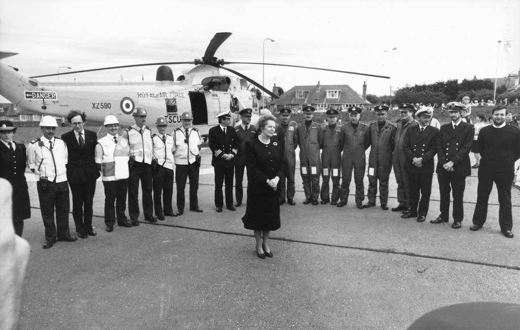 The mood of the nation is reflected on the face of Mrs Thatcher as she arrives at Aberdeen Royal Infirmary's helipad to meet some of the front-line rescue workers involved in the Piper Alpha disaster.  She also met some of the survivors and hospital staff who are caring for them,   09/07/1988