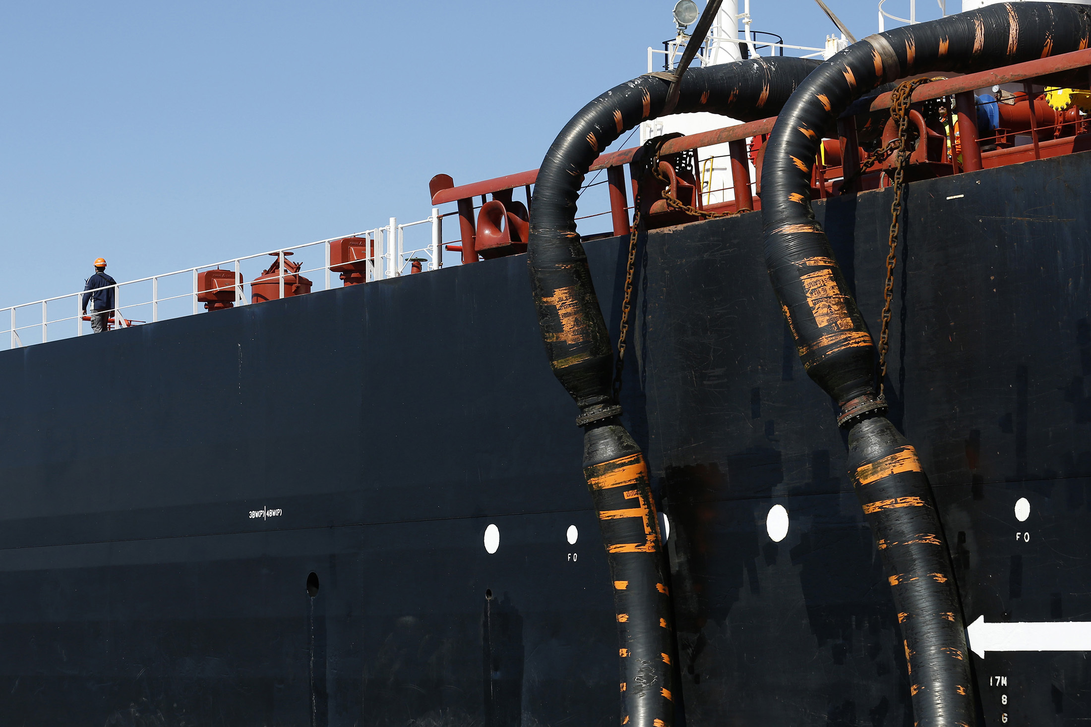 Oil pipes connect the Monte Toledo oil tanker to an offshore pumping station as it delivers a shipment of Iranian oil to the Cia. Espanola de Petroleos SA (CEPSA) refinery near Algeciras, a few miles from Gibraltar. Photographer: Luke MacGregor/Bloomberg
