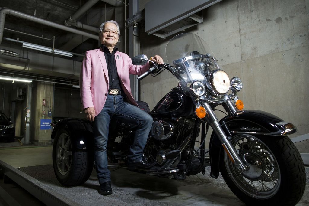 Hiroyuki Kawai, lawyer and filmmaker, poses with his Harley-Davidson Inc. Trike motorcycle inside a garage in Tokyo, Japan, on Tuesday, July 25, 2017. Attorney at law Photographer: Tomohiro Ohsumi/Bloomberg