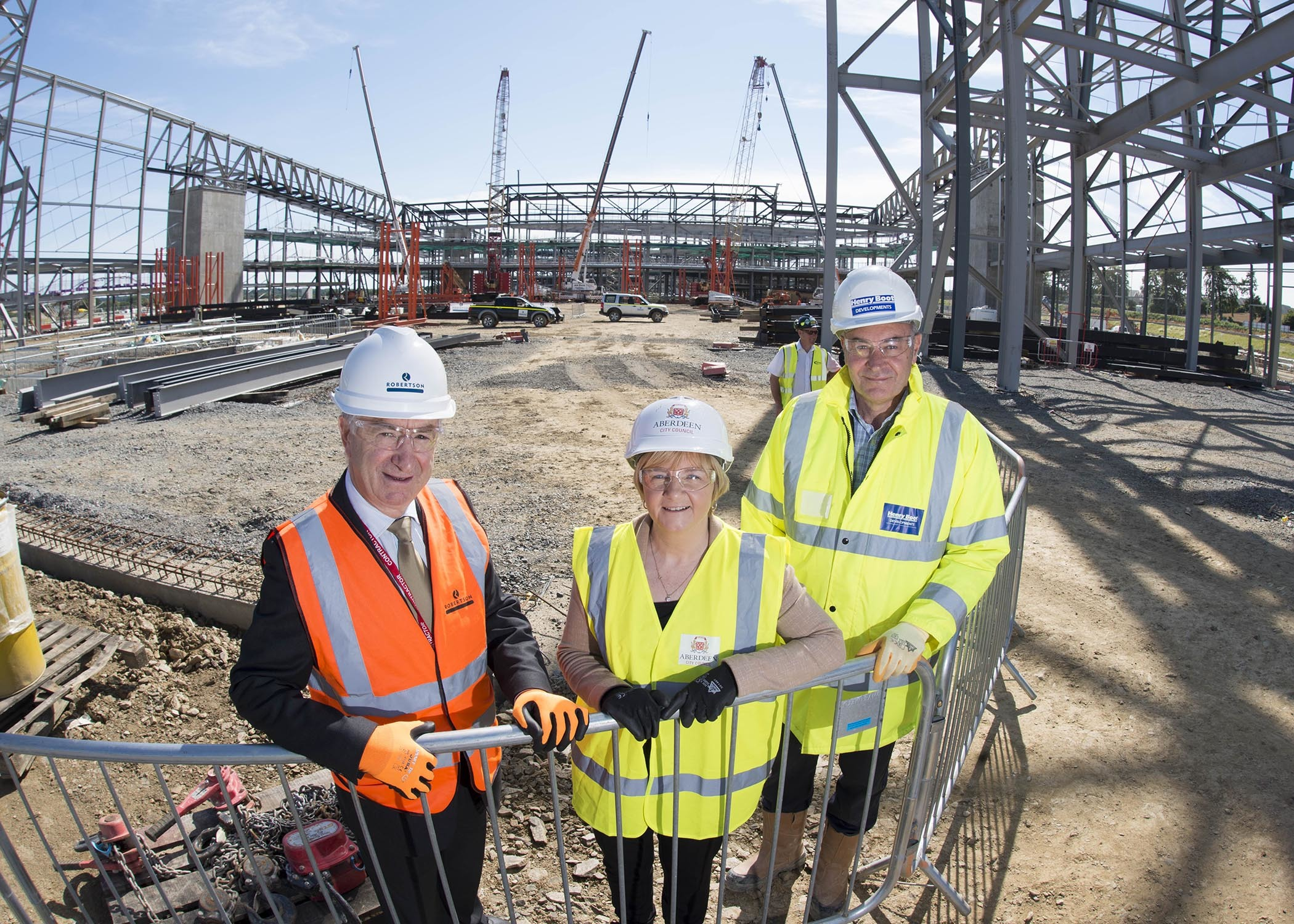 Council leader Jenny Laing with Bill Robertson, left, founder of the Robertson Group, and Nigel Munro, senior project manager at Henry Boot Developments
