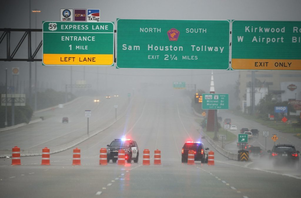 HOUSTON, TX - AUGUST 27:  Police shut down highway 69 due to flooding from Hurricane Harvey on August 27, 2017 in Houston, Texas. Harvey, which made landfall north of Corpus Christi late Friday evening, is expected to dump upwards to 40 inches of rain in Texas over the next couple of days.  (Photo by Joe Raedle/Getty Images)
