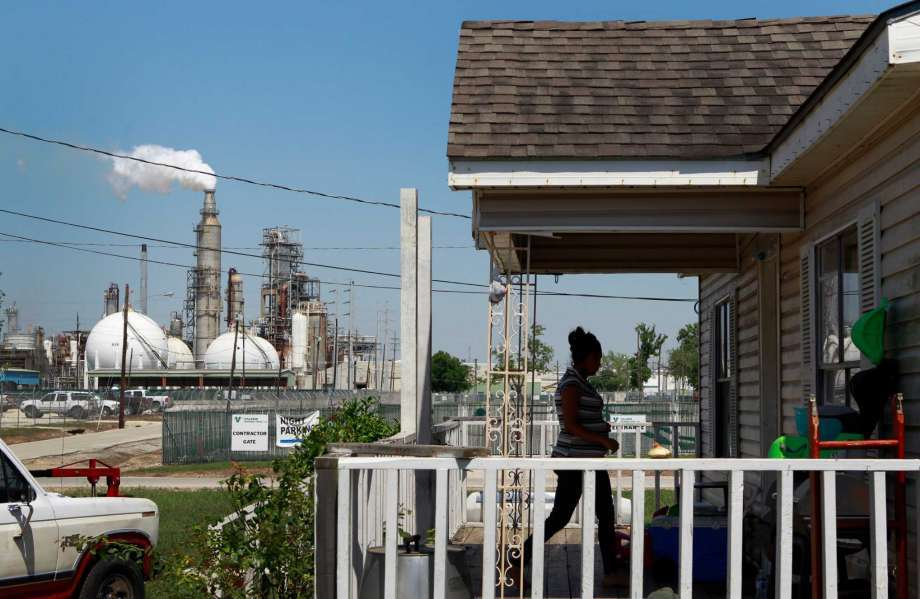 Griselda Silva walks into her sister's home along East Avenue P at Central St. across from the Valero Houston Refinery Thursday, May 15, 2014, in Houston.