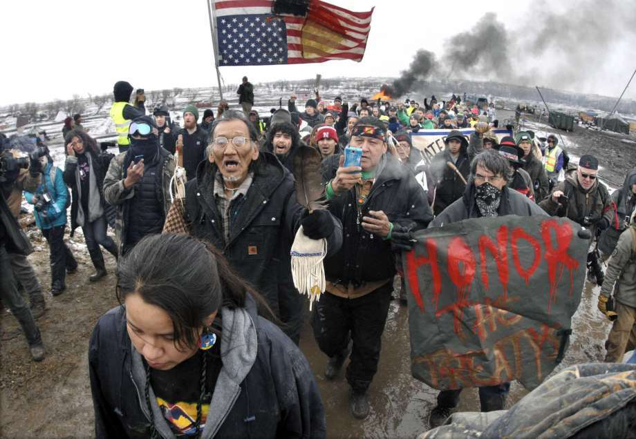 Dakota Access Pipeline protesters march out of their camp in February before the deadline set for evacuation by the U.S. Army Corps of Engineers.