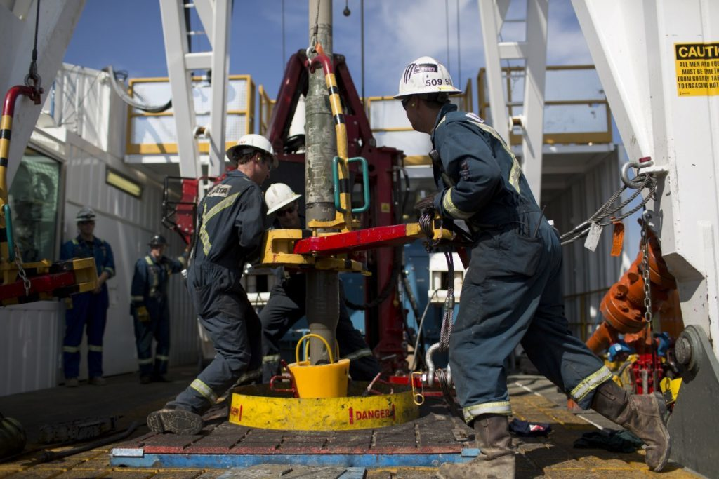 Employees torque a pipe at a wedge well at Christina Lake, a situ oil production facility half owned by Cenovus Energy Inc. and ConocoPhillips, in Conklin, Alberta, Canada, on Thursday, Aug. 15, 2013. Photographer: Brent Lewin/Bloomberg