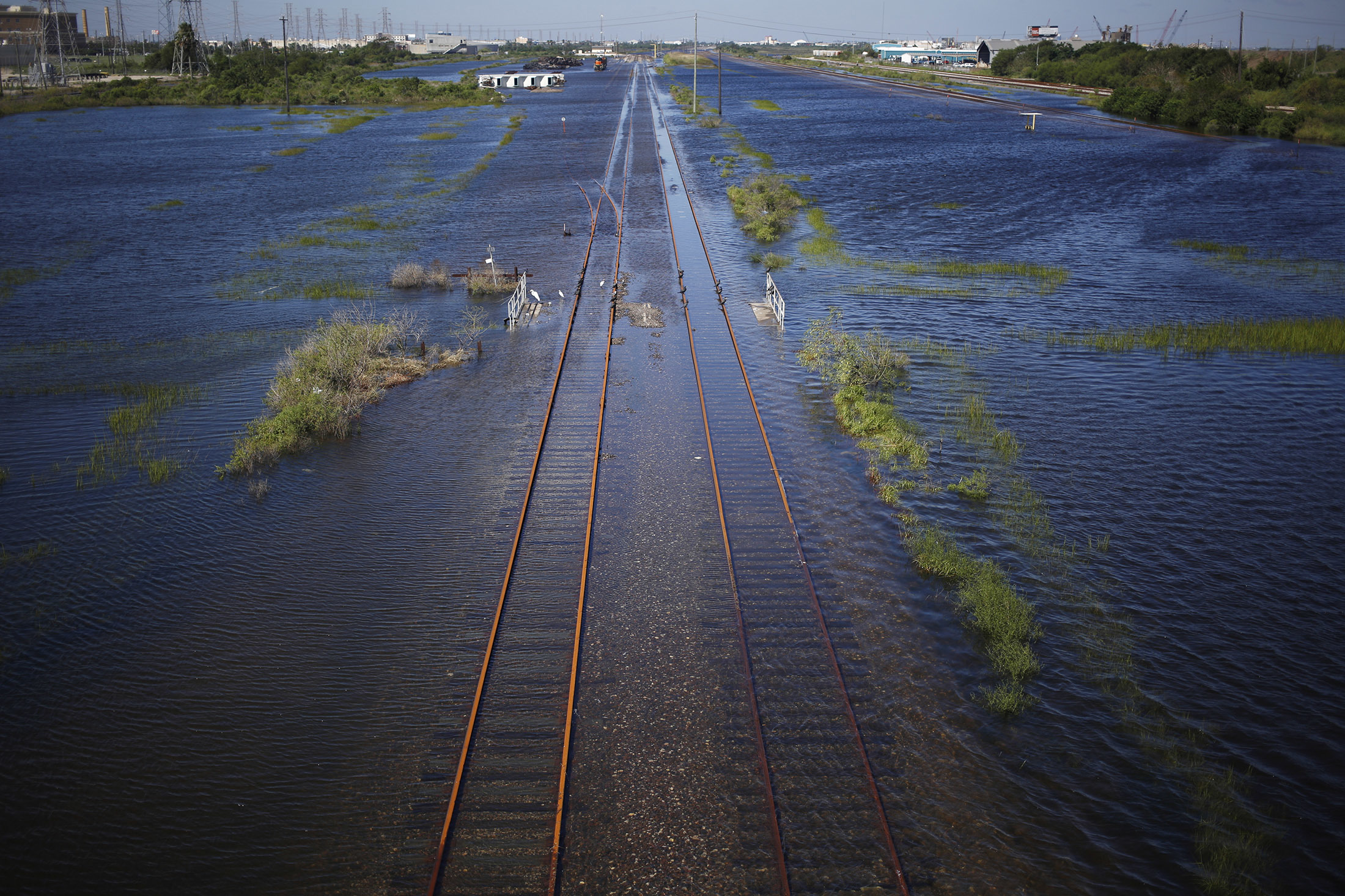 Railroad tracks are seen covered in floodwaters from Hurricane Harvey in Galveston, Texas, U.S., on Wednesday, Aug. 30, 2017. Unprecedented flooding from the Category 4 storm that slammed into the state's coast last week, sendinggasoline pricessurging as oil refineries shut, may also set a record for rainfall in the contiguous U.S., the weather service said Tuesday. Photographer: Luke Sharrett/Bloomberg