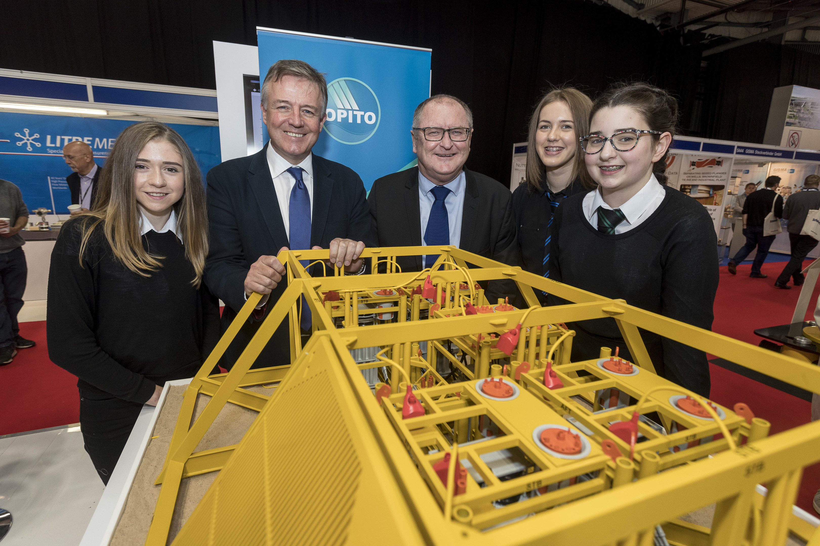 OPITO International chairman Gordon Ballard with OPITO chief executive John McDonald with Turriff Academy pupils Vicki Elder, Christina Mair and Molly Mathieson.jpg
