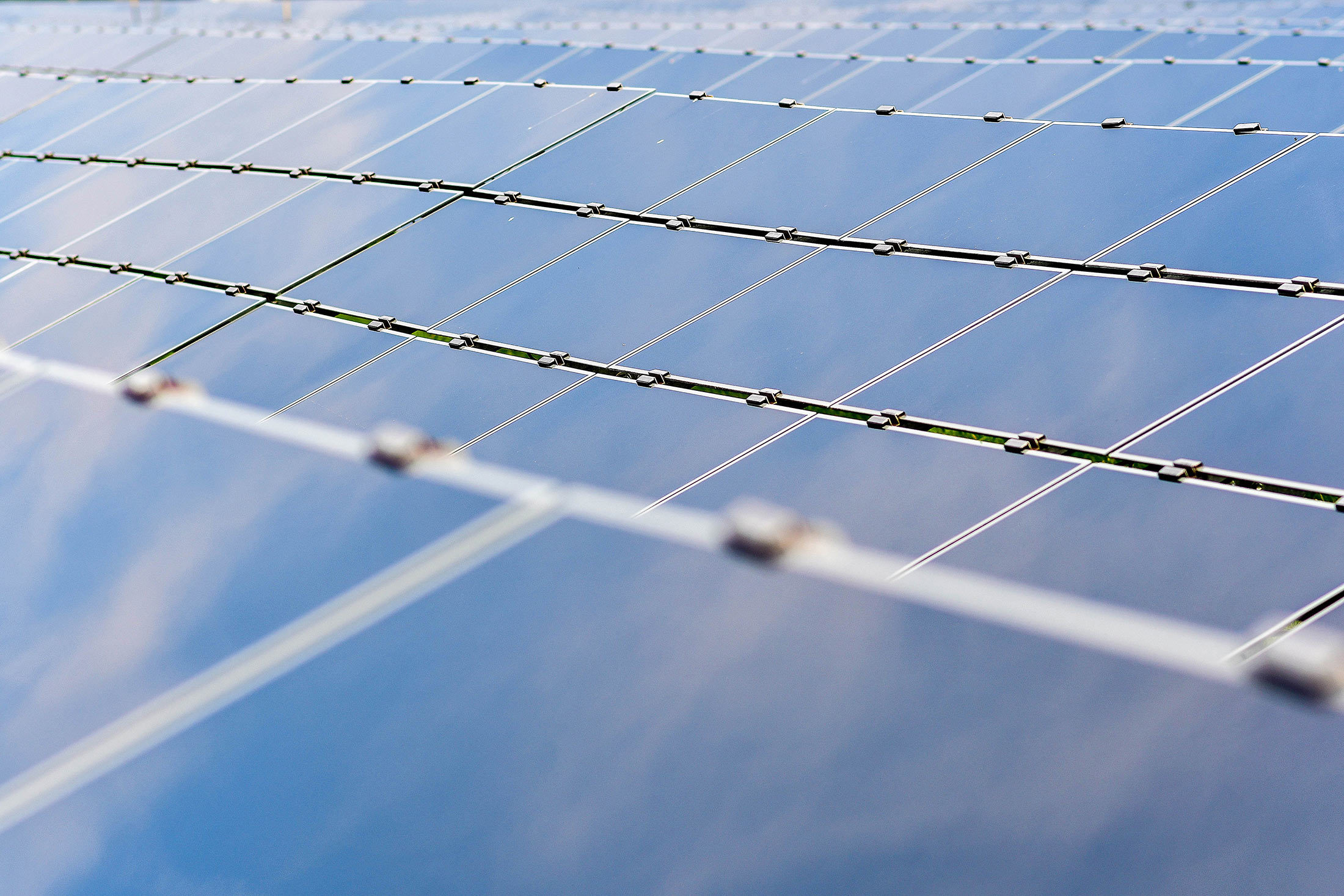 Solar panels stand at the Enbridge Inc. Sarnia Solar Farm in Sarnia, Ontario, Canada, on Friday, July 21, 2017. The Sarnia Solar Farm, which became fully operational in the fall of 2010, was at the time one of the largest photovoltaic solar farms in the world. It was also Enbridge's first ever foray into solar energy, costing $400 million. Photographer: James MacDonald/Bloomberg