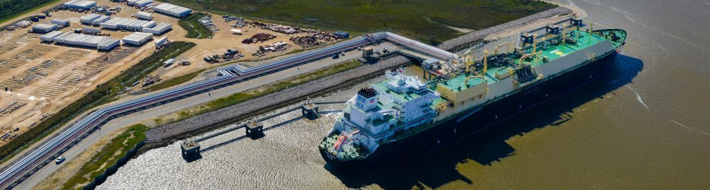 The Asia Vision LNG carrier ship sits docked at the Cheniere Energy Inc. terminal in this aerial photograph taken over Sabine Pass, Texas, U.S., on Wednesday, Feb. 24, 2016. Cheniere said in a statement last month. Cheniere Energy Inc. expects to ship the first cargo of liquefied natural gas on Wednesday to Brazil with another tanker to be loaded a few days later, marking the historic start of U.S. shale exports and sending its shares up the most in more than a month. Photographer: Lindsey Janies/Bloomberg