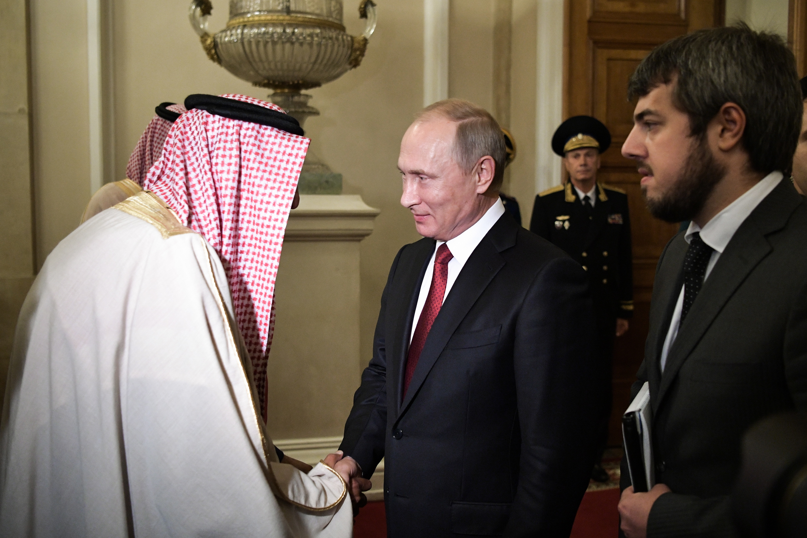 King Salman bin Abdulaziz Al Saud (L) of Saudi Arabia shakes hands with Russia's President Vladimir Putin (C) following their talks at the Moscow Kremlin. Alexei Nikolsky/Russian Presidential Press and Information Office/TASS (Photo by Alexei NikolskyTASS via Getty Images)