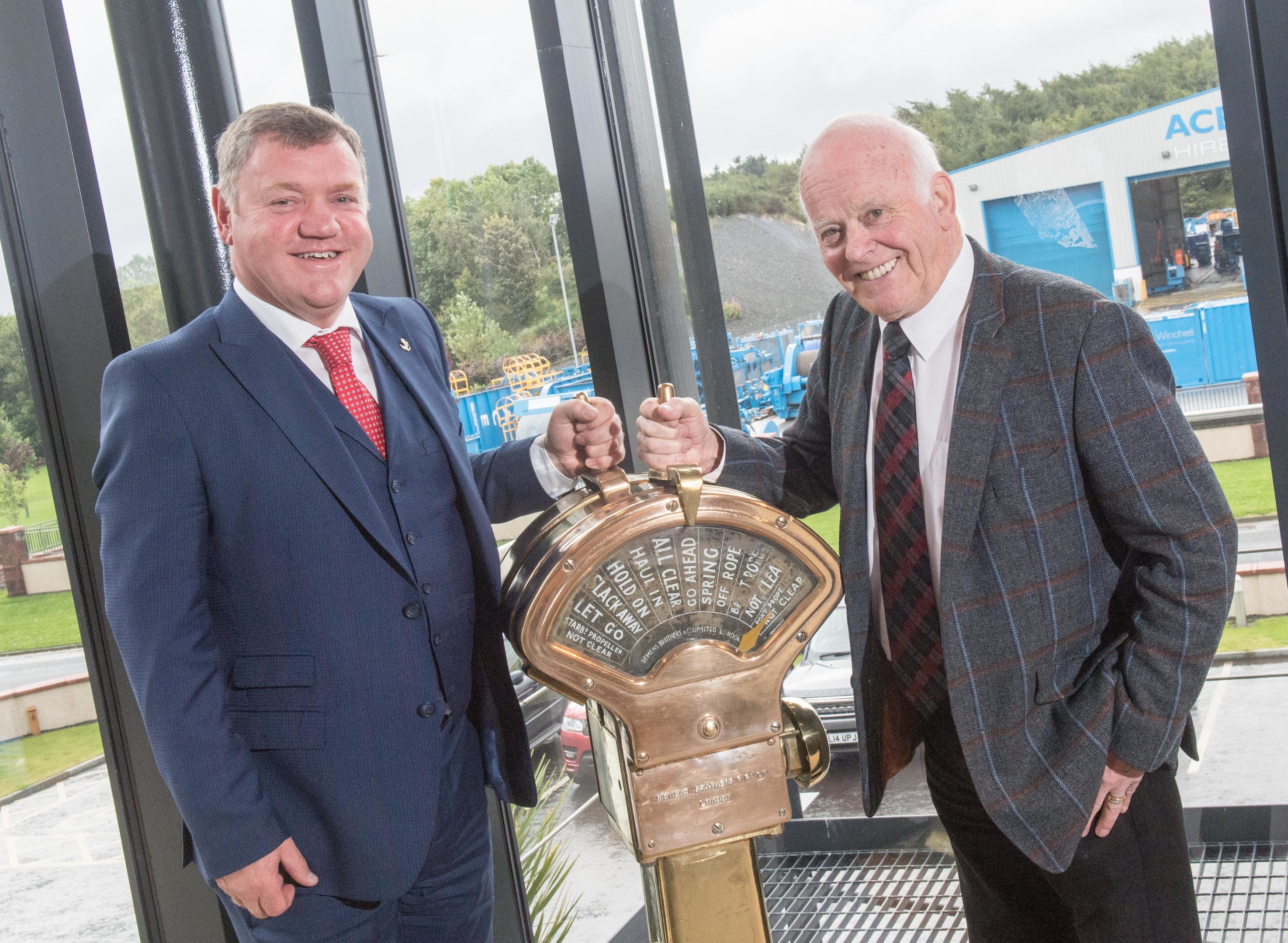 Alfie Cheyne, founder of Ace Winches (left) and Jim Milne, chairman and managing director of Balmoral Group, announcing their partnership in 2017.
