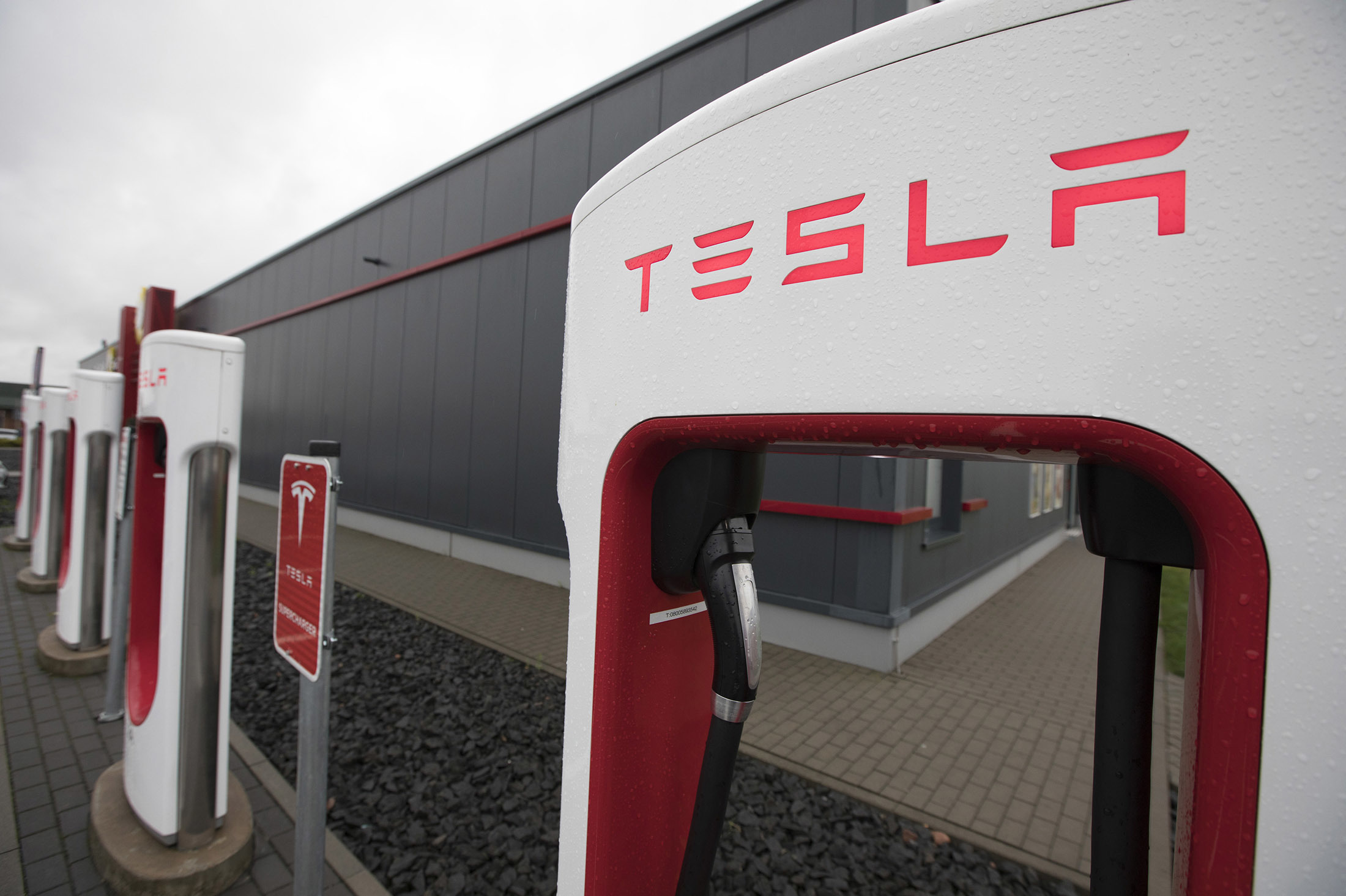 A Tesla Inc. Model X electric automobile charging station stands in Frankfurt, Germany, on Friday, Aug. 11, 2017. Germany's government wants carmakers to increase efforts to reach its goal of 1 million electric vehicles on German roads by 2020, Steffen Seibert, Chancellor Angela Merkels spokesman, told reporters today in Berlin. Photographer: Alex Kraus/Bloomberg