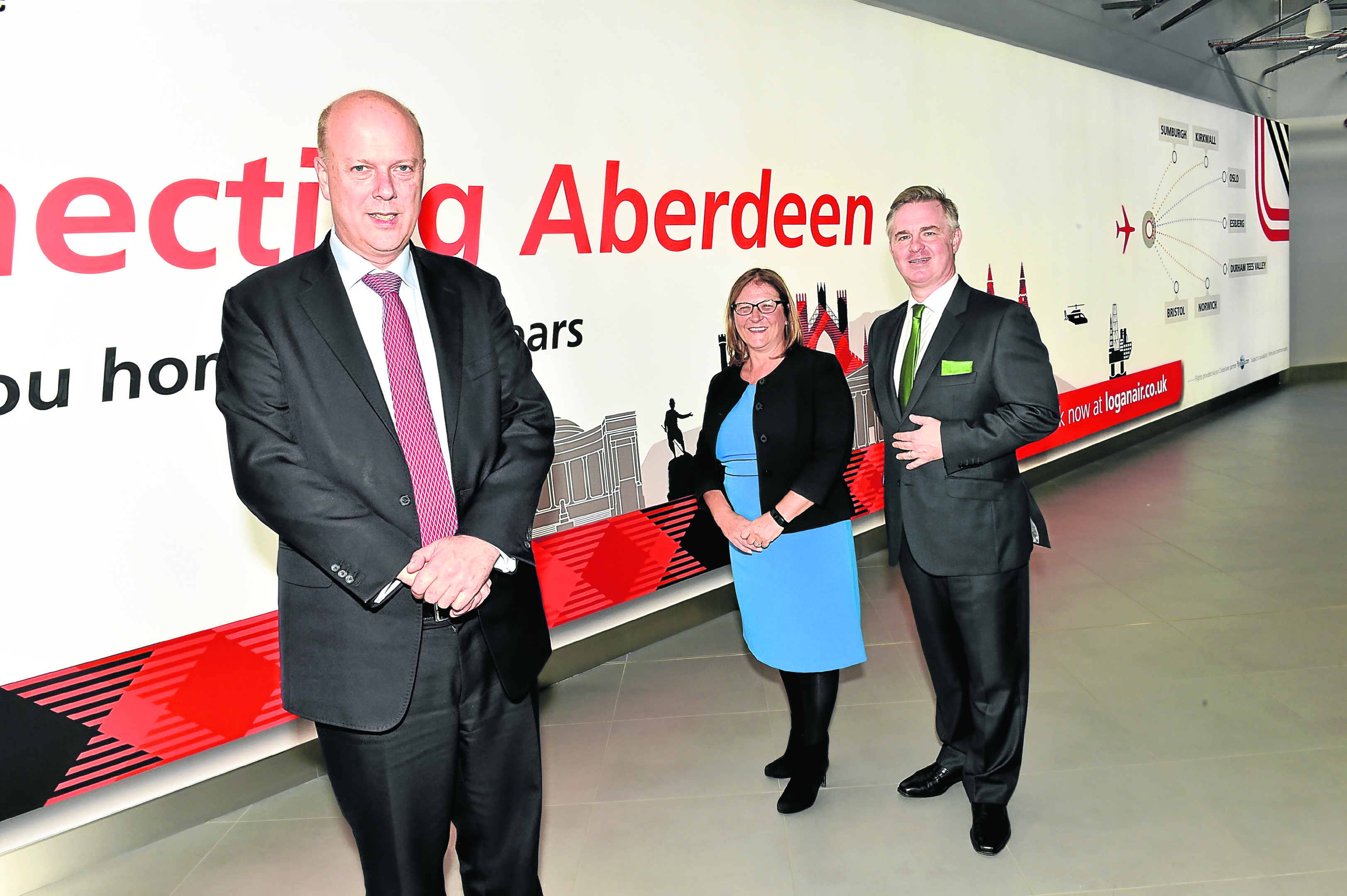 VISIT: Chris Grayling with Aberdeen Airport MD Carol Benzie and MP Colin Clark. Photograph by Colin Rennie