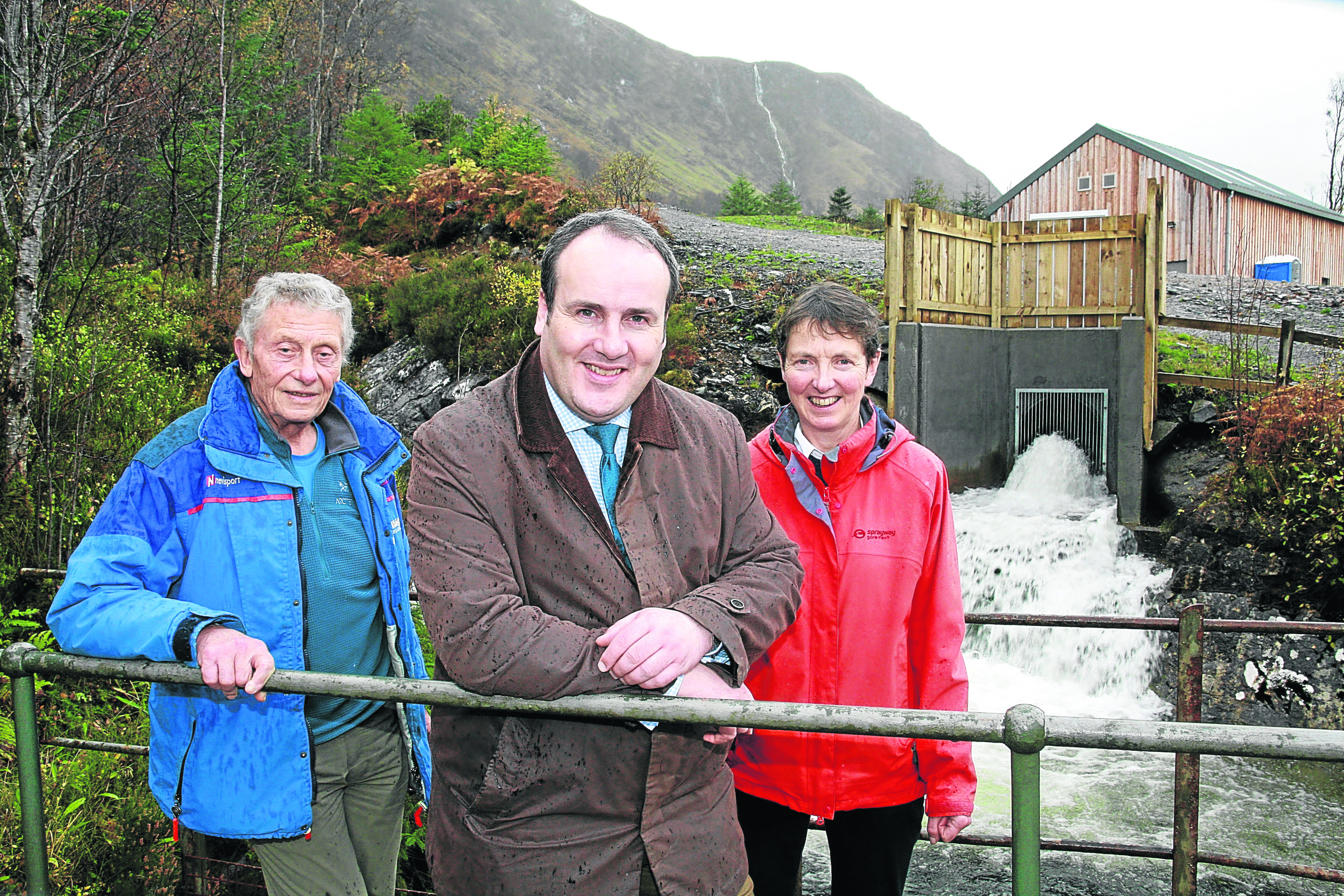 Ben Nevis Hydro Pictured at the opening of the new Hydro scheme at Nevis Range ( picture at water left to right) Ian Sykes chair of Nevis Range Board, Paul Wheelhouse MSP Minister for Business Innovation and Energy and Marian Austin Director Nevis Range Hydro Company. Story Rita Campbell Picture Anthony MacMillan Photography