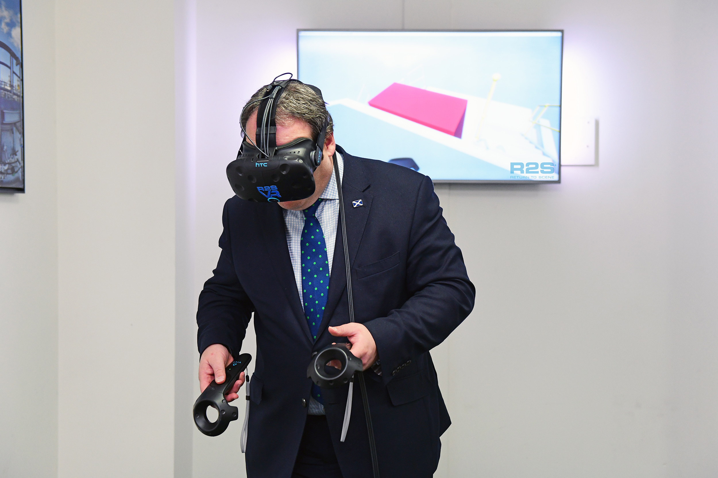 Paul Wheelhouse testing out virtual reality tech during his visit to Return To Scene