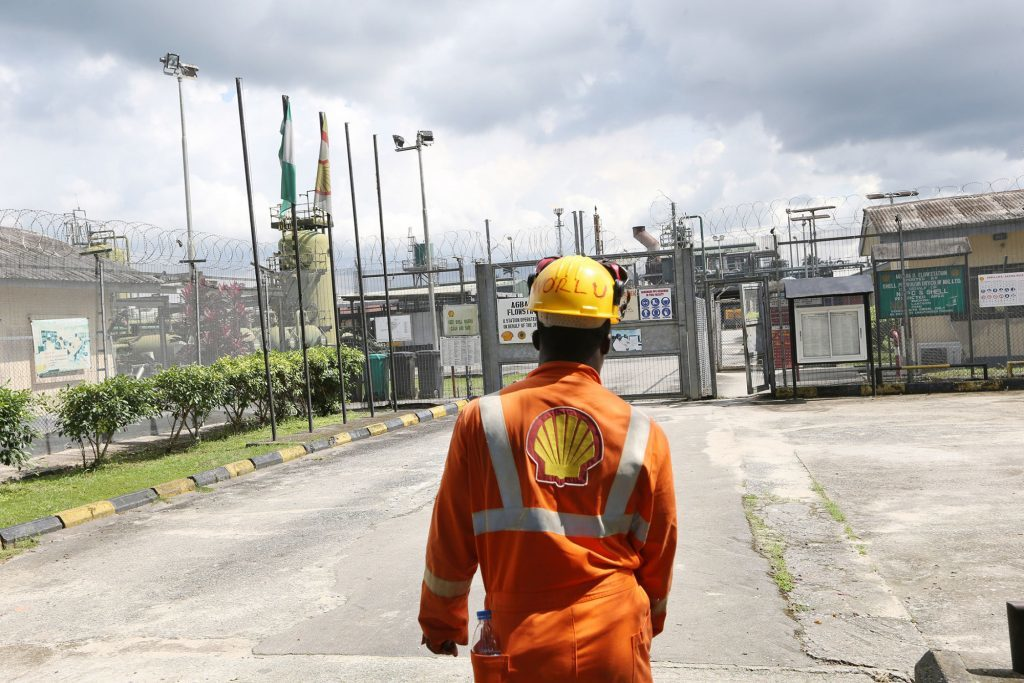 An employee approaches the entrance to the Agbada 2 oil flow station, operated by Shell Petroleum Development Co. (SPDC) in Port Harcourt, Nigeria, on Wednesday, Sept. 30, 2015.  Photographer: George Osodi/Bloomberg