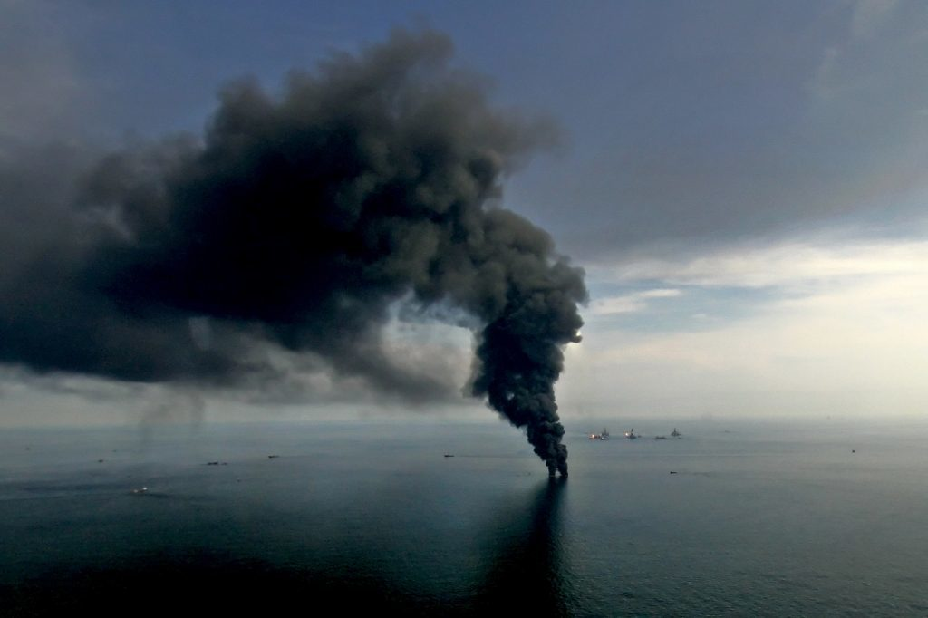 Smoke billows from controlled oil burns near the site of the BP Plc Deepwater Horizon oil spill in the Gulf of Mexico off the coast of Louisiana on June 19, 2010. Photographer: Derick E. Hingle/Bloomberg