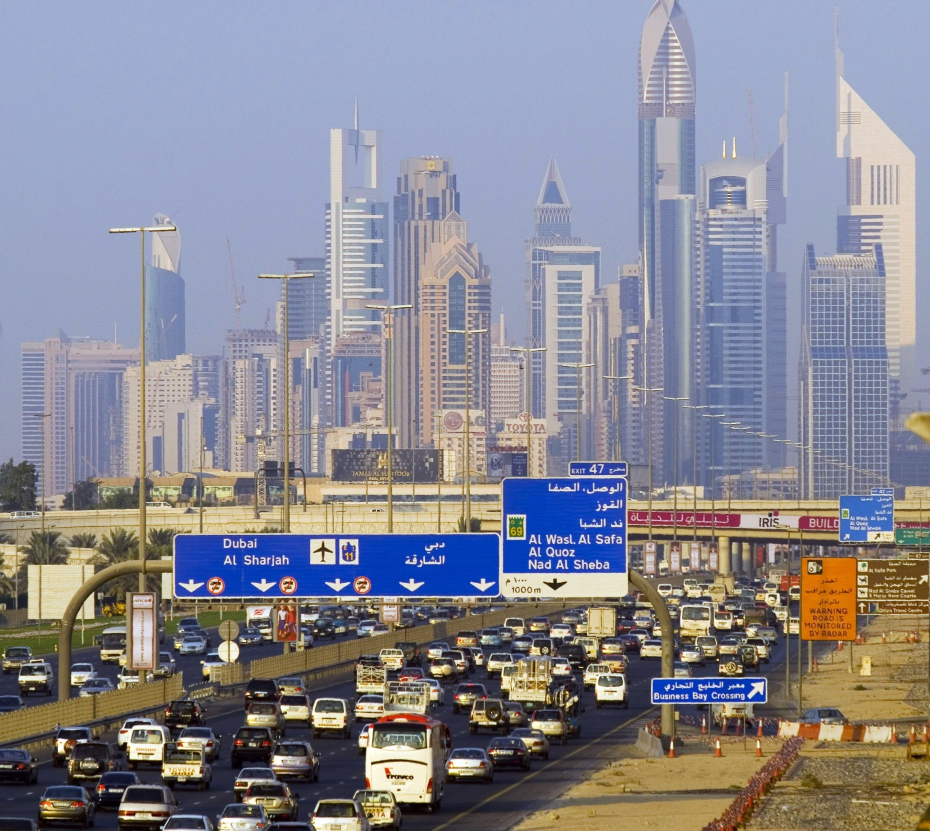 Commuters travel down Sheikh Zayed Road into Dubai, United Arab Emirates, on Sunday, Nov. 4, 2007. Dubai is situated on the Persian Gulf coast of the U.A.E. Photographer: CHARLES CROWELL