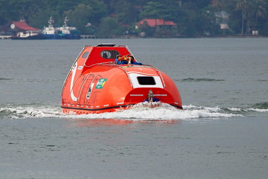 A self-propelled hyperbaric lifeboat in water during trial