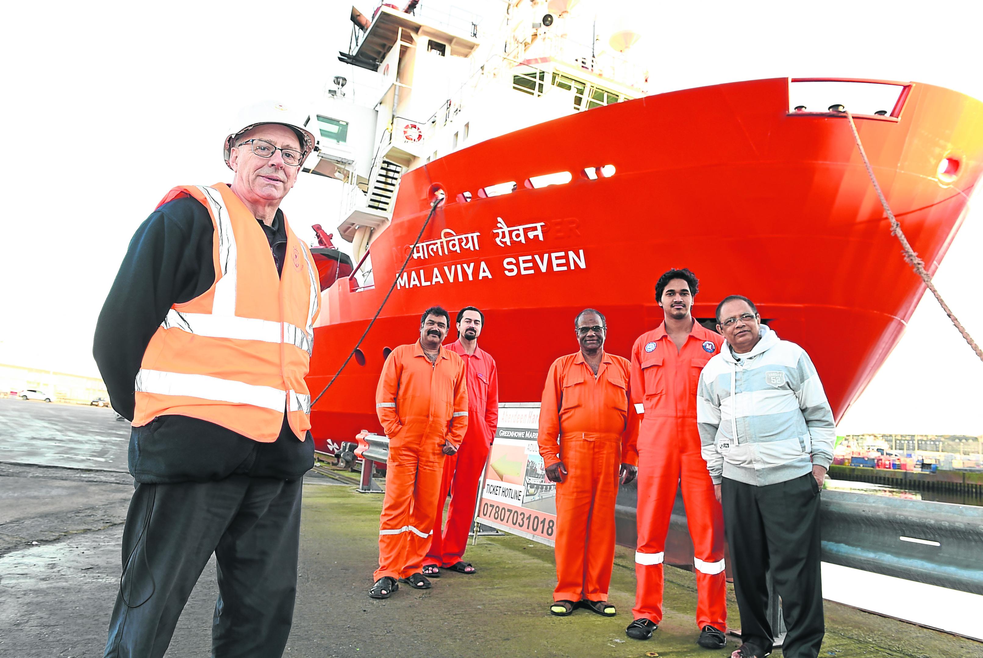 (from left) Doug Duncan, the Aberdeen port chaplain for Catholic charity Apostleship of the Sea, with Malaviya Seven crew members Clay Vaz, Ashish Prabhakar, Bamadev Swain, Rahul Sharma and captain L.B. Singh.