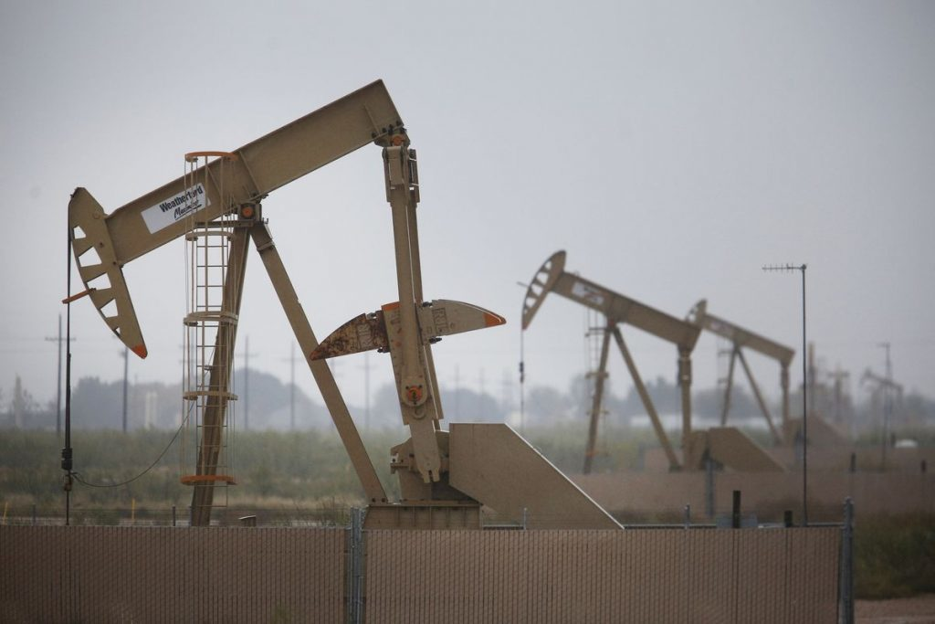 Electric oil pump jacks stand in the oil fields surrounding Midland, Texas, U.S., on Wednesday, Nov. 8, 2017. Photographer: Luke Sharrett/Bloomberg