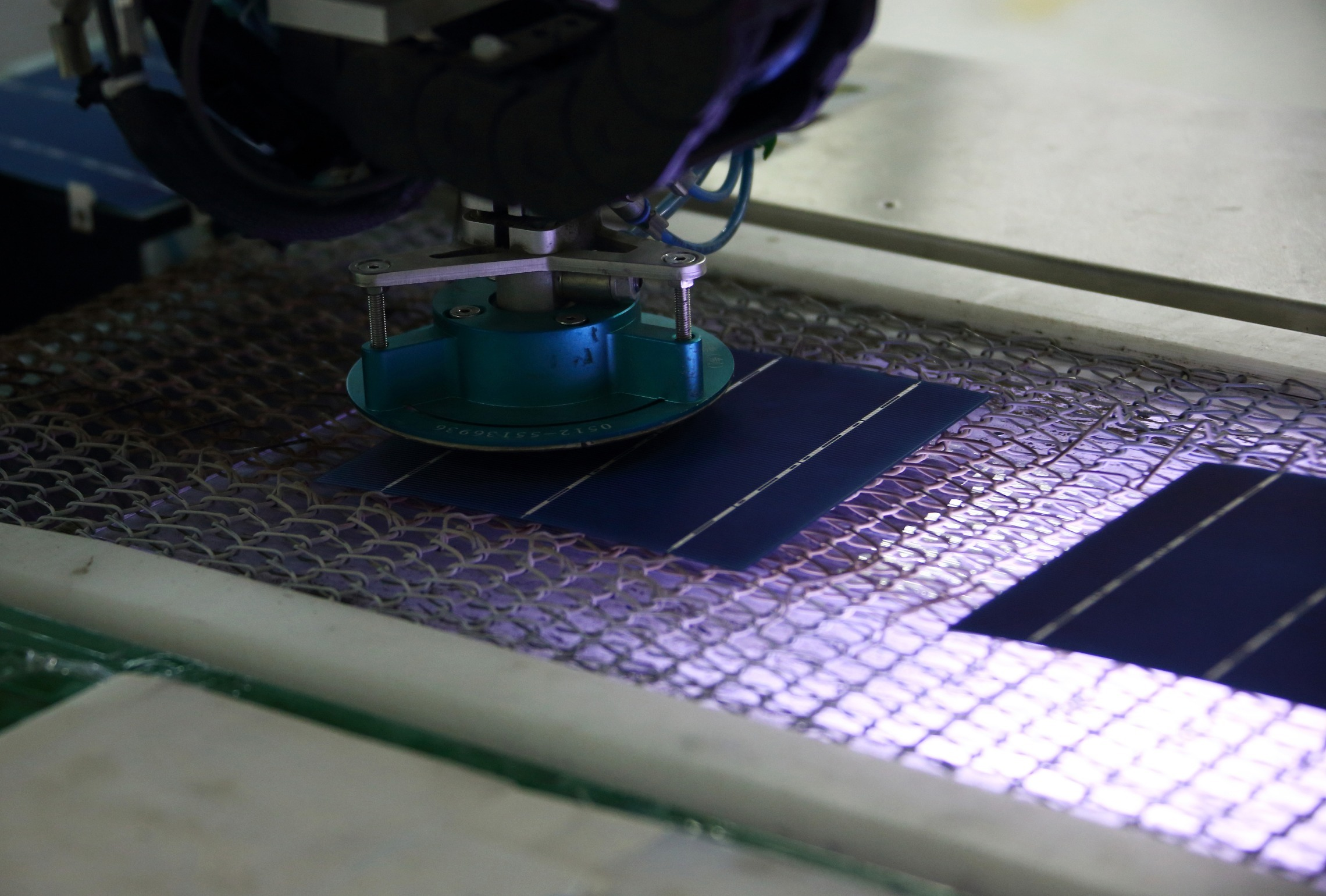 Solar cells move along the production line at the Trina Solar Ltd. factory in Changzhou, Jiangsu Province, China. Photographer:Tomohiro Ohsumi/Bloomberg