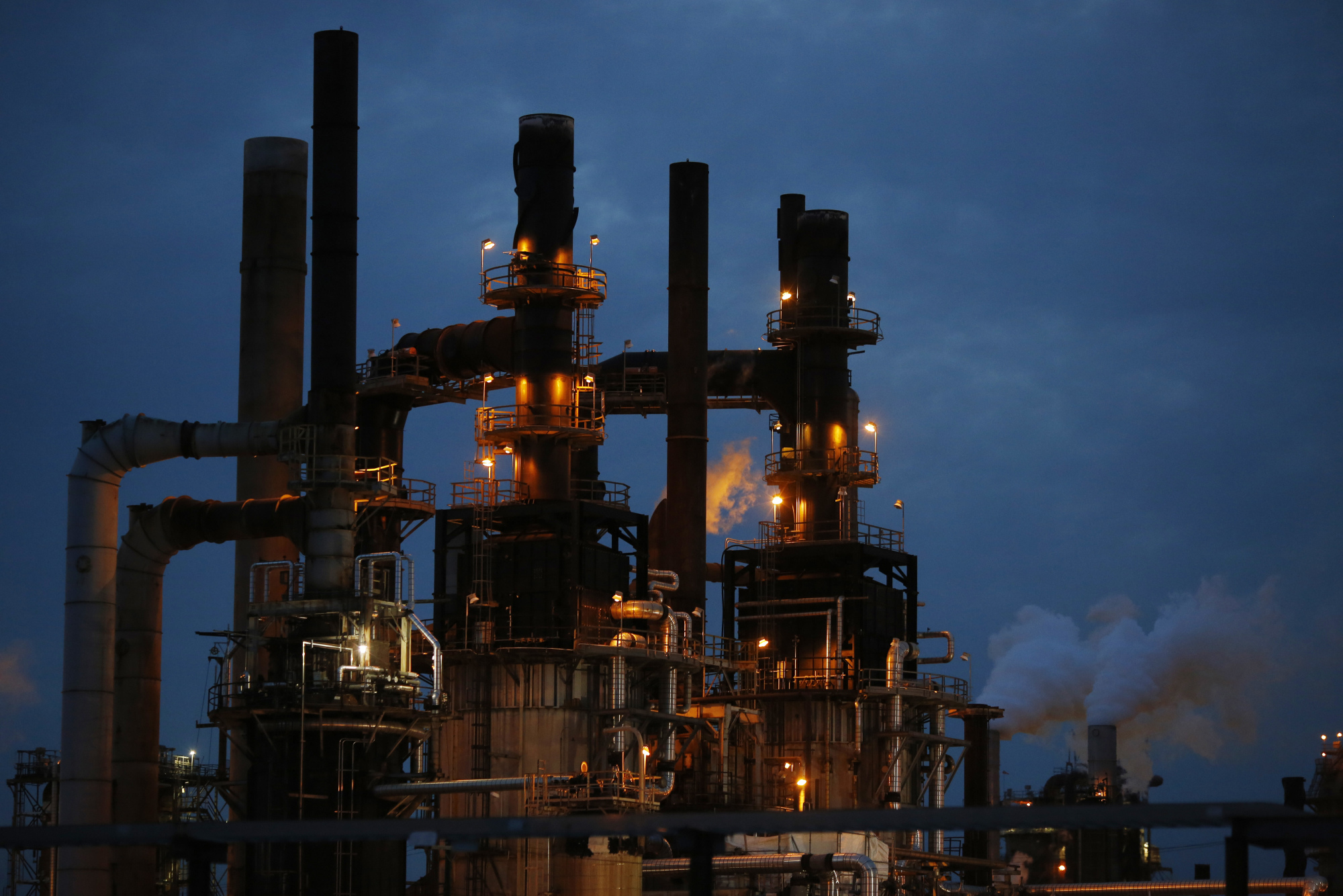 The Phillips 66 Wood River Refinery stands at dusk in Roxana, Illinois, U.S., on Tuesday, April 24, 2017. Photographer: Luke Sharrett/Bloomberg