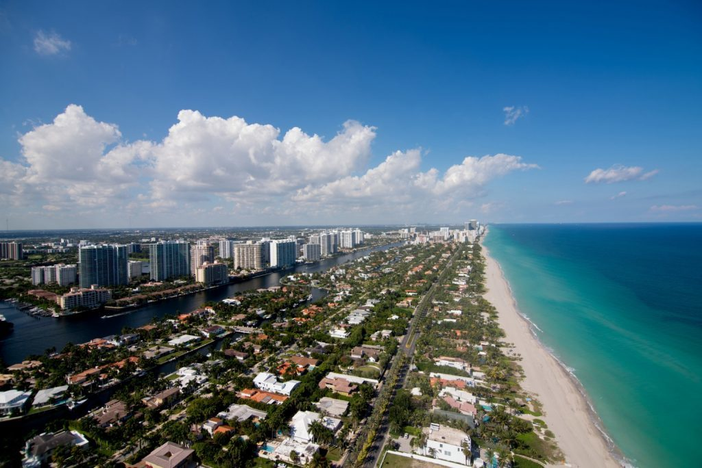 Beachfront homes are seen in the view from the penthouse of the Regalia luxury condominium in Miami Beach, Florida, U.S., on Tuesday, Feb. 11, 2014.  Photographer: Christina Mendenhall/Bloomberg