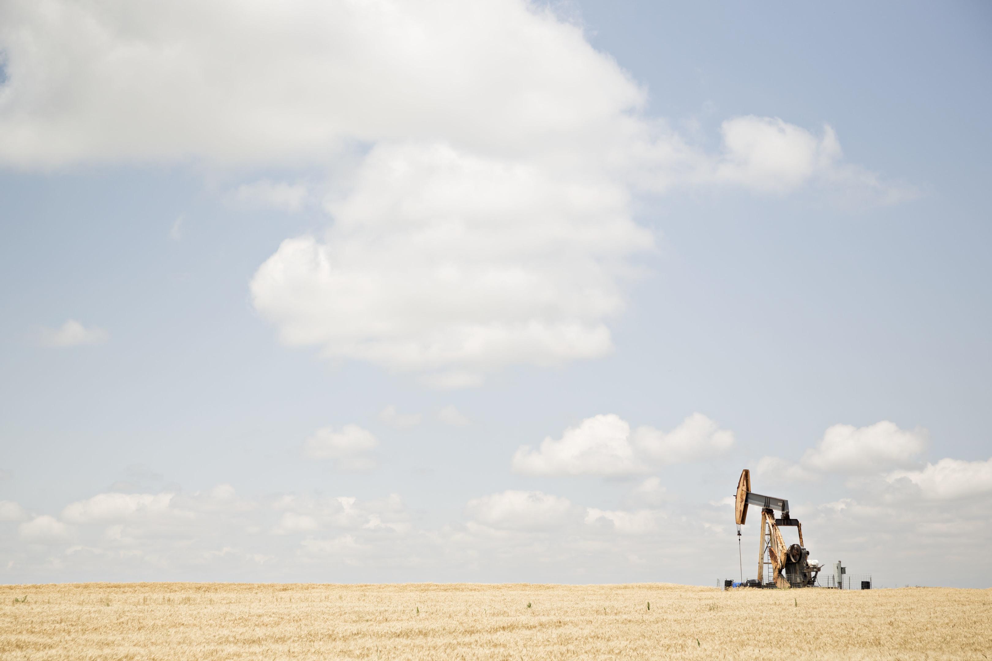 A pumpjack operates in the Bemis-Shutts oil field near Hays, Kansas, U.S., on Thursday, June 29, 2017. Photographer: Daniel Acker/Bloomberg