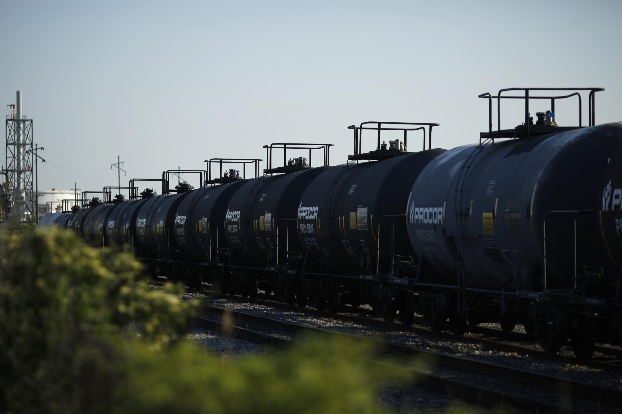 "Tanker cars sit parked in a CSX Transportation Inc. rail yard near the BP-Husky Toledo Refinery in Oregon, Ohio, U.S., on Monday, June 12, 2017. Global natural gas production stagnated last year as lower prices damped U.S. output for the first time since the shale boom started. Gas production was ""adversely affected by low prices, growing by only 0.3 percent,"" BP Plc said in its annual Statistical Review. Photographer: Luke Sharrett/Bloomberg"